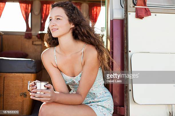 Woman relaxing in camper van