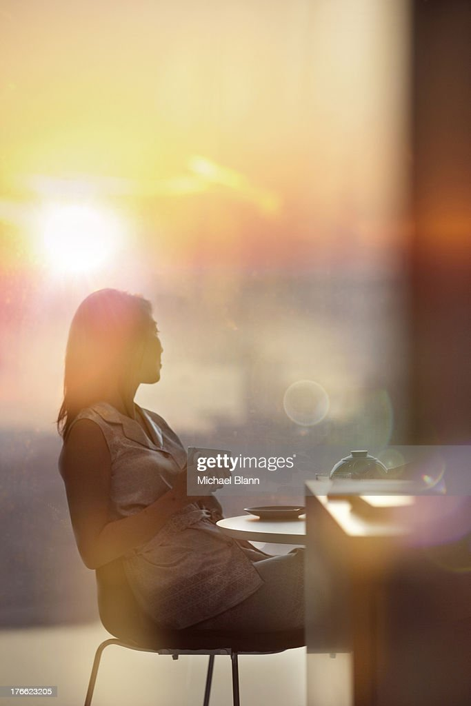 Woman relaxing in City apartment
