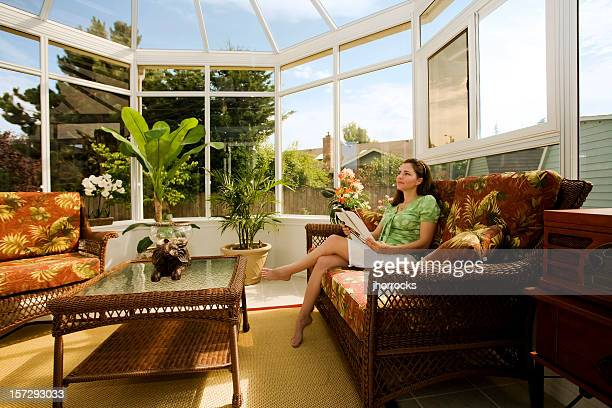Woman Relaxing in Cozy Conservatory