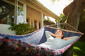 Woman relaxing in hammock, otudoors