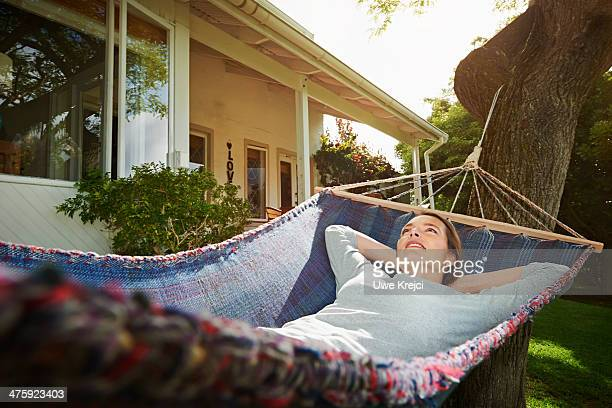 Woman relaxing in hammock, otudoors