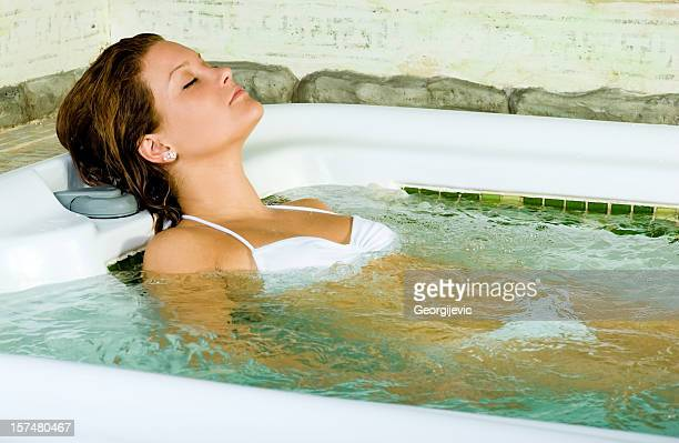 Woman relaxing in jacuzzi