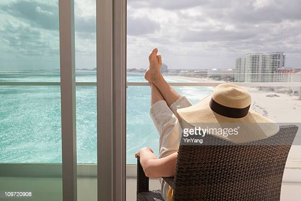 Woman Relaxing in Hotel Balcony of Beach Resort