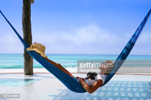 Woman Relaxing in Infinity Pool Hammock