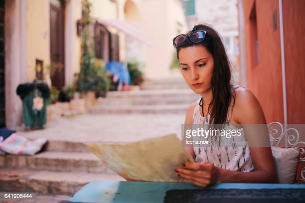 Woman relaxing in Rovinj sidewalk cafe