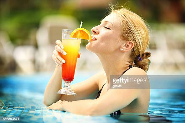 Woman relaxing in swimming pool.