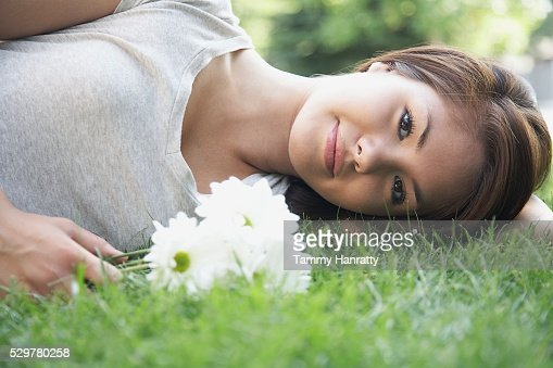 Woman relaxing in the grass : Stock Photo