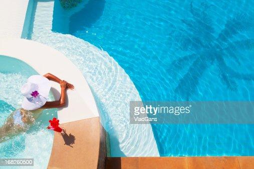 woman relaxing in waterpool