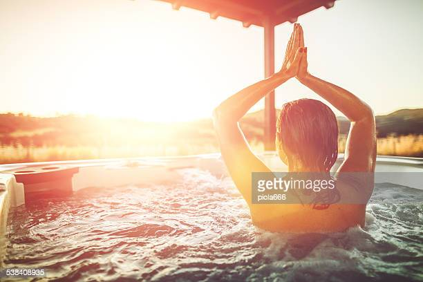 Woman relaxing in whirlpool jacuzzi