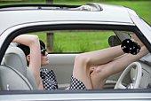 Woman relaxing inside car