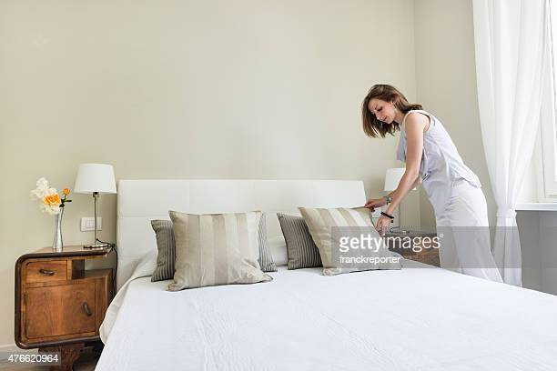 Woman relaxing inside her beautiful bedroom