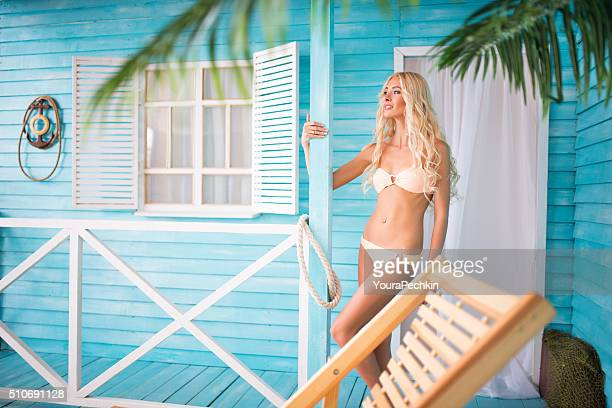 Woman relaxing near bungalows
