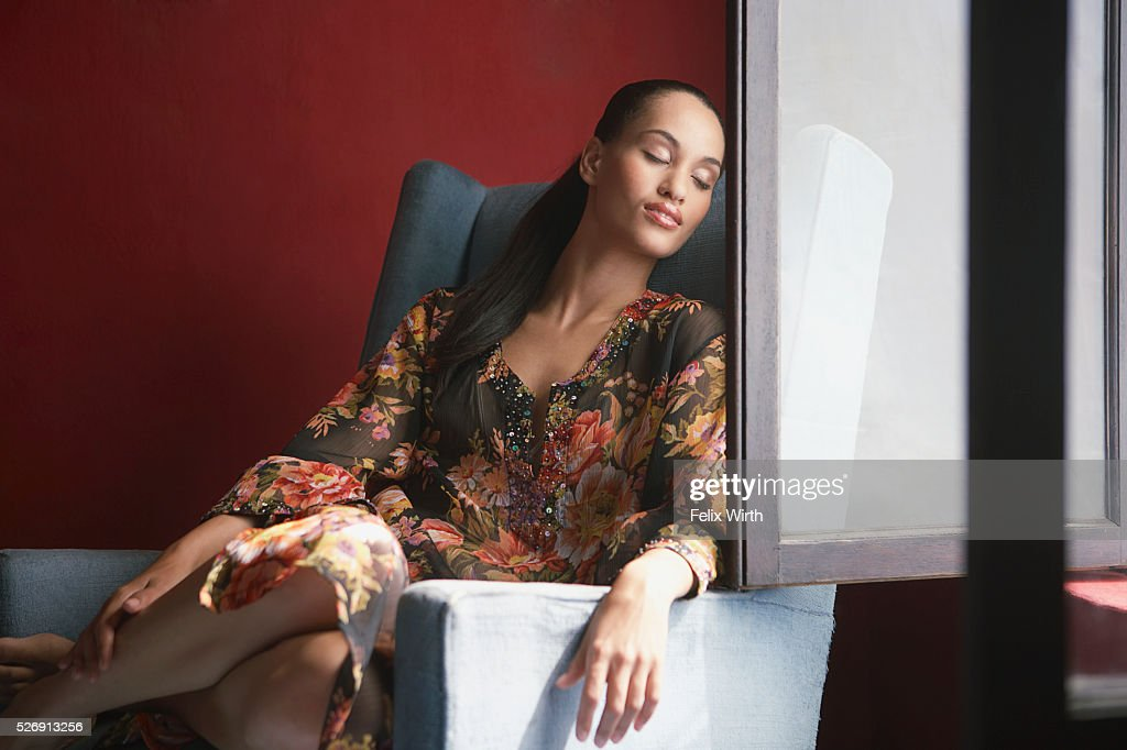 Woman relaxing near window : Stock Photo