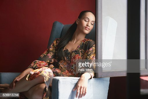 Woman relaxing near window : Foto de stock