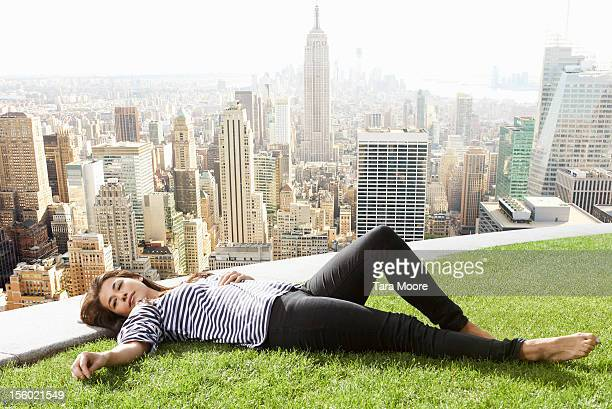 woman relaxing next to new york city skyline