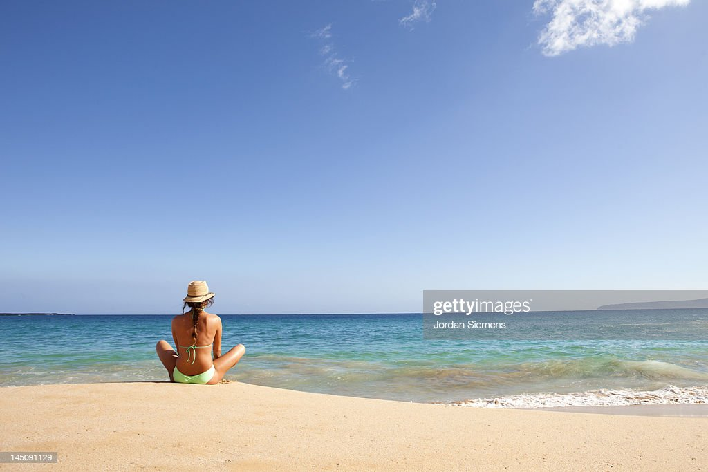 A woman relaxing on a beach. : Stock Photo