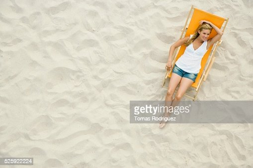 Woman Relaxing on a Beach : Foto de stock