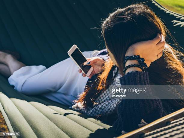 woman relaxing on a hammock