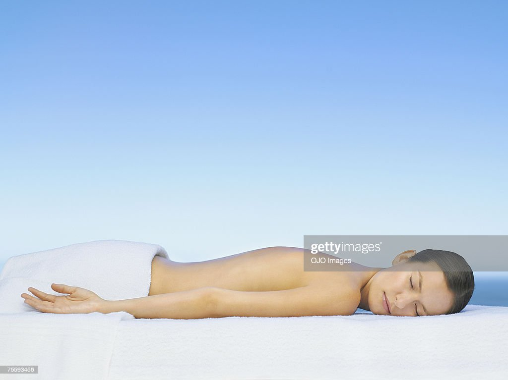 Woman relaxing on a massage table : Stock Photo