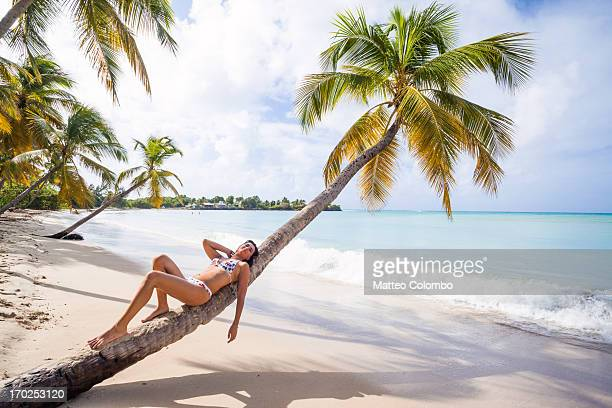 Woman relaxing on a palm in the Caribbean