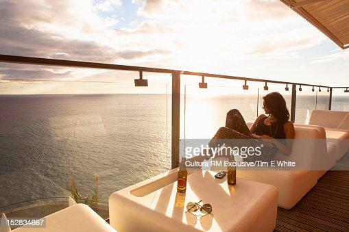 Woman relaxing on bar balcony
