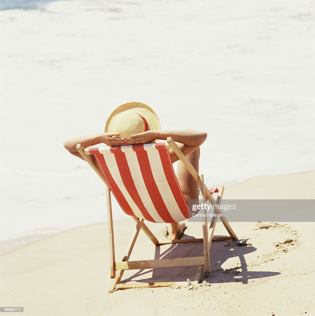Woman Relaxing On Beach Chair Stock Photo