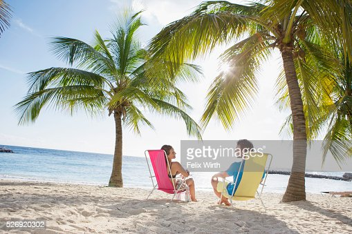 Woman relaxing on beach lounger : Stock Photo