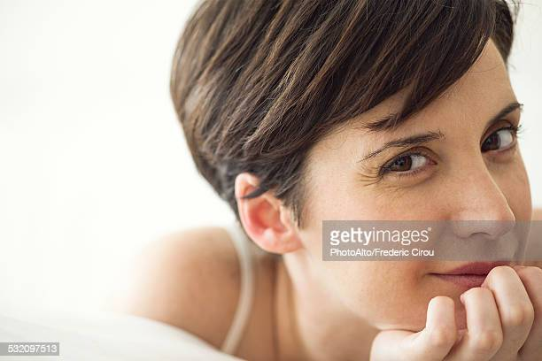 Woman relaxing on bed, portrait