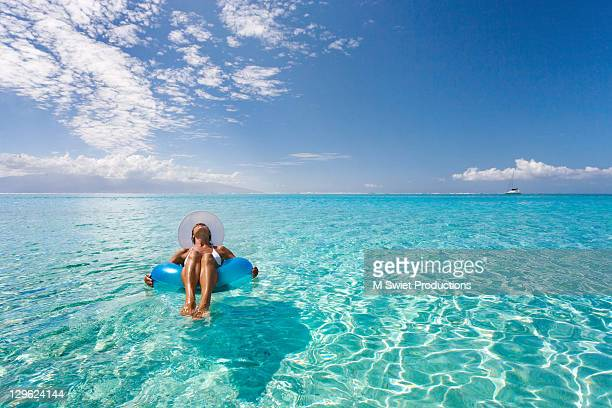 Woman relaxing on floating