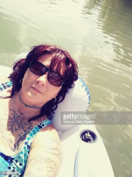 Woman Relaxing On Inflatable Ring At Colorado River