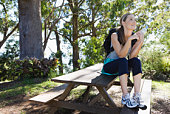 Woman relaxing on picnic table