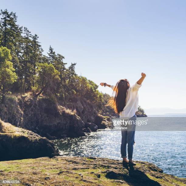 woman relaxing on shore