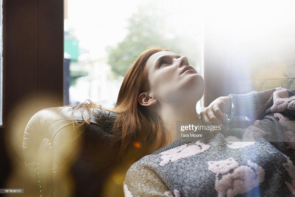 woman relaxing on sofa : Stock Photo