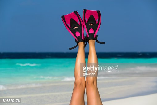 Woman relaxing on summer beach vacation holidays lying in sand. : Stock Photo