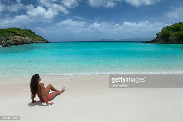 Woman relaxing on tropical beach in the Caribbean