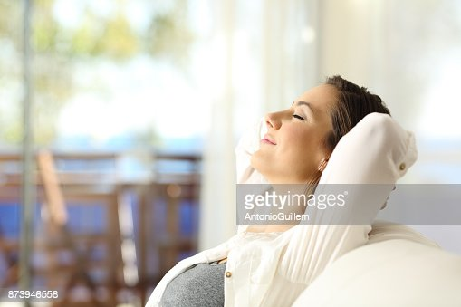 Woman relaxing on vacations in an apartment : Stock Photo