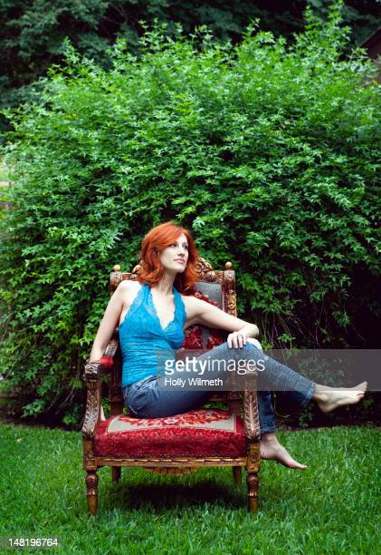 Woman relaxing outdoors in armchair
