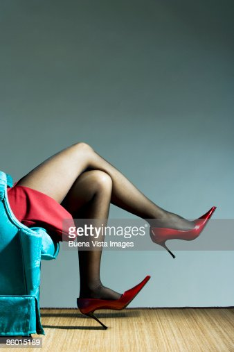 Woman relaxing, wearing red high heal shoes