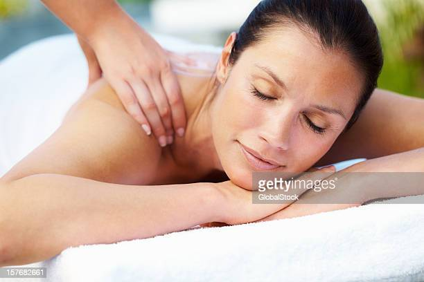 Woman relaxing while receiving a massage