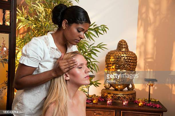 Woman relaxing while receiving Ayurveda massage