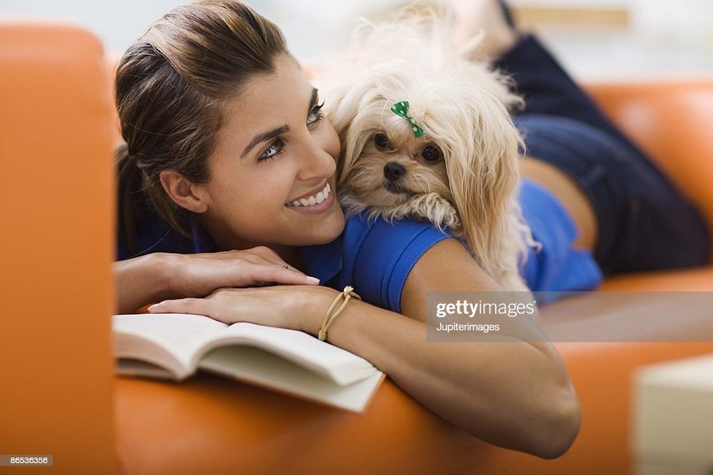 Woman relaxing with a dog : Stock Photo