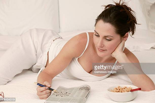 Woman relaxing with crossword puzzle