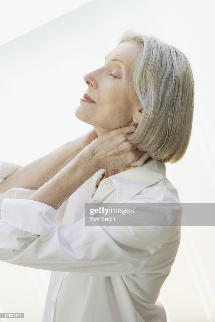 Woman relaxing with her hands on the back of her neck : Stock Photo