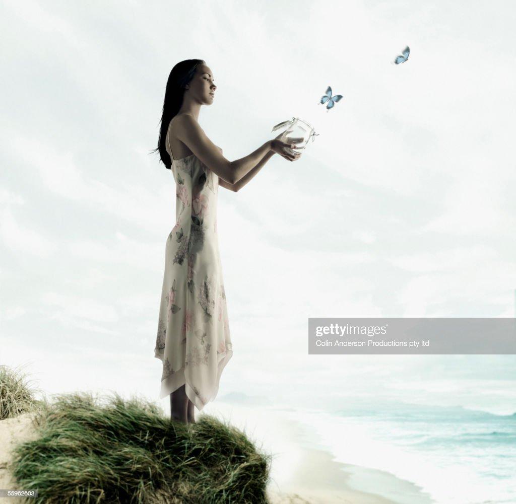 Woman releasing butterflies