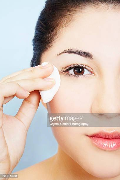 Woman removing makeup