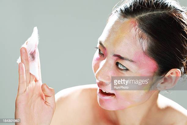 Woman Removing Makeup with a Cotton