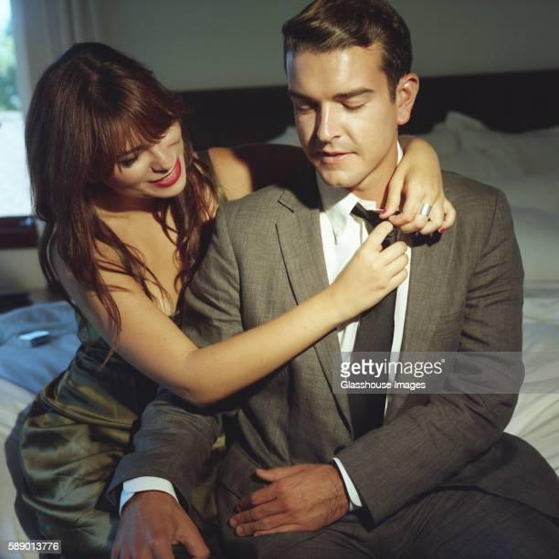 Woman Removing Man's Tie