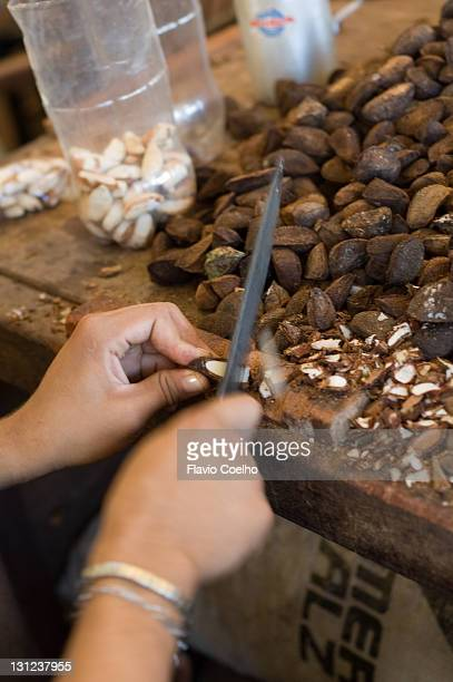Woman removing nuts shell