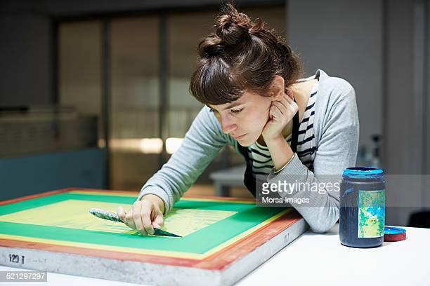 Woman reparing a silk screen
