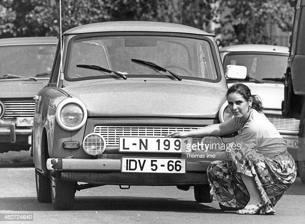 Woman replacing her old GDR license plate by a new one which matches the license plates of the German Federal Republic on September 07 in Leipzig...